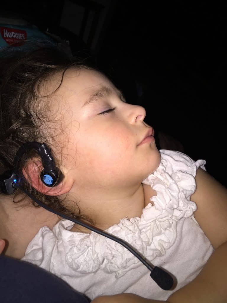 child with vibration therapy earphone and microphone on